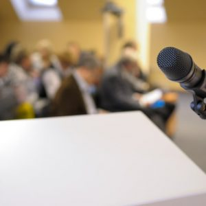 Microphone stand at conference. Microphone stand by lectern at conference.